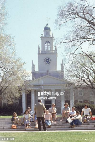 A class is held outdoors on the steps in front of Samuel Phillips Hall at Phillips Academy Andover Massachusetts May 1978