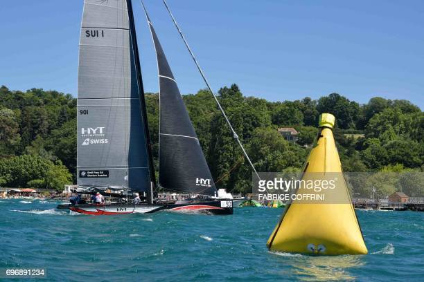 Class M1 boat 'Alinghi 1' crosses the finish line to win the 79th edition of the Bol d'Or sailing race on Lake Geneva on June 17 2017 About 550...