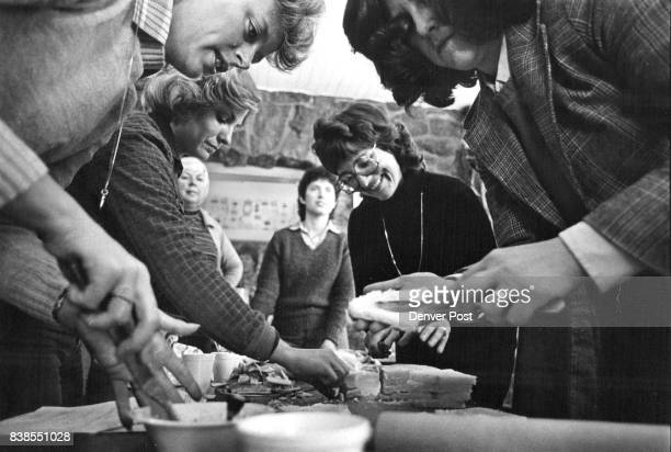 Class members spread trimmed flattened bread with mayonnaise The result will be wrapped around asparagus spears and baked for a farfrom routine...
