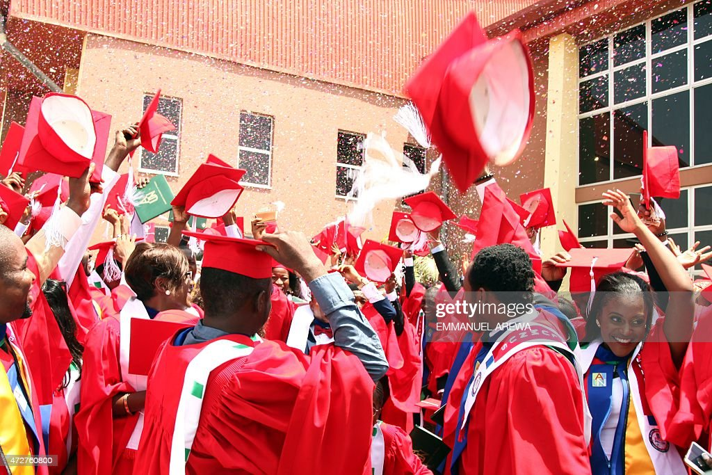 Class of 2015 graduating students of the American University of Nigeria in Yola, Adamawa state, celebrate after their commencement ceremony at the school on May 9, 2015. Amongst them is Abubakar Umar, a 26-year-old petroleum chemistry student who survived a Boko Haram attack last November as he travelled home to the city of Kano, surviving with the help of villagers and without medication for two broken arms. He returned to finish his education with his arms in casts in January, winning an award for his courage as well as his degree.