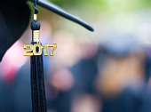 Image of a graduation cap with a 2017 tassel hanging down at a graduation ceremony
