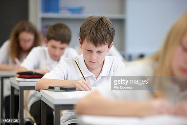 Class of schoolchildren doing educational exam