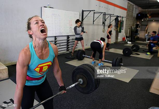 Lita Collins does a deadlift during a CrossFit workout at Ross Valley CrossFit on March 14 2014 in San Anselmo California CrossFit a high intensity...