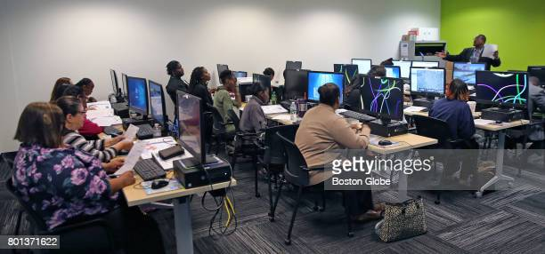 A class takes place at the MBTA's new 'centralized call center' for The Ride in Malden MA on Jun 16 2017