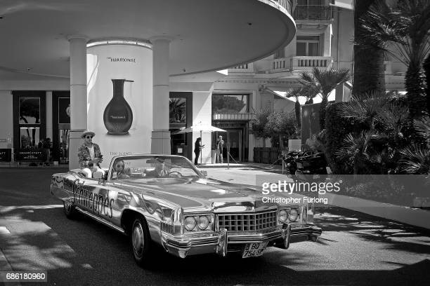 A classic American car drives along the Boulevard de la Croisette during annual Cannes Film Festival at Palais des Festivals on May 20 2017 in Cannes...