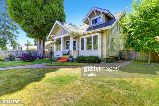 Classic american house exterior front yard stock photo for Classic sliders yard house