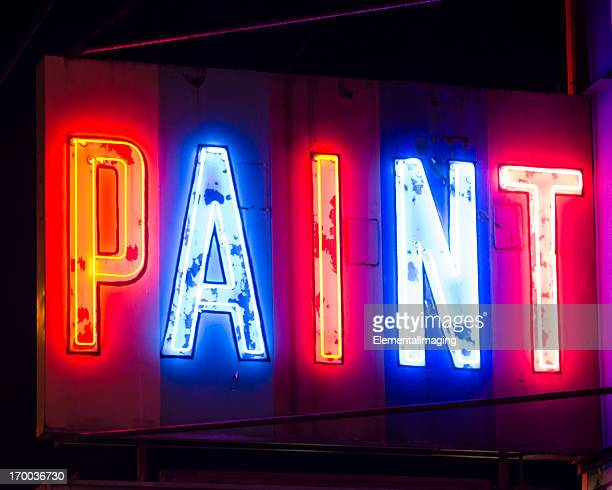 Classic Americana Glowing Multi-Colored Neon Paint Sign at Night