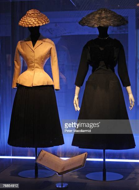 A classic 'Bar' suit and hat and a Maxim's restaurant dress and hat both by Christian Dior from 1947 are displayed at the Golden Age of Couture...