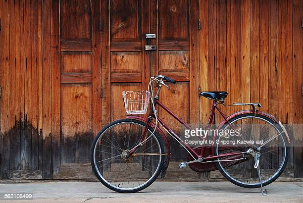 Classic bicycle in front of the wooden house