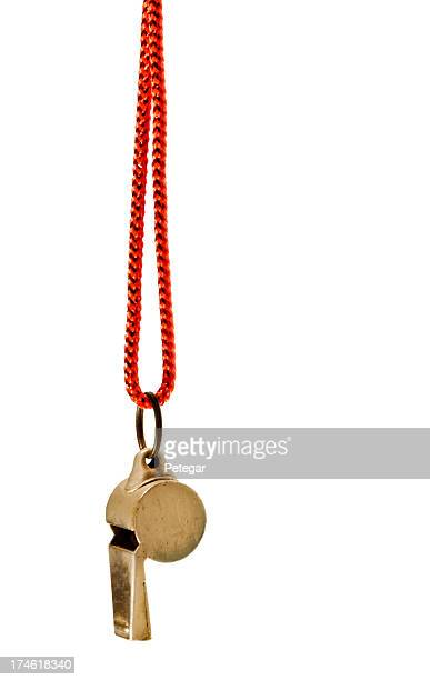 Classic brass whistle with red cord against white background