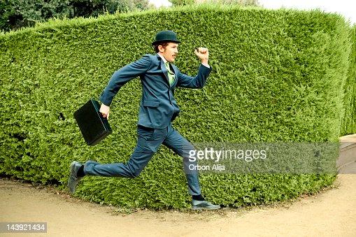 Classic businessman running