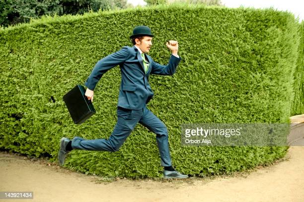 Classic businessman running