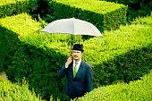 Classic businessman with an umbrella