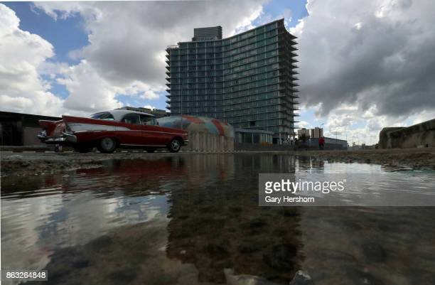A classic car drives along the Malecon past the famed Riviera Hotel on October 8 2017 in Havana Cuba