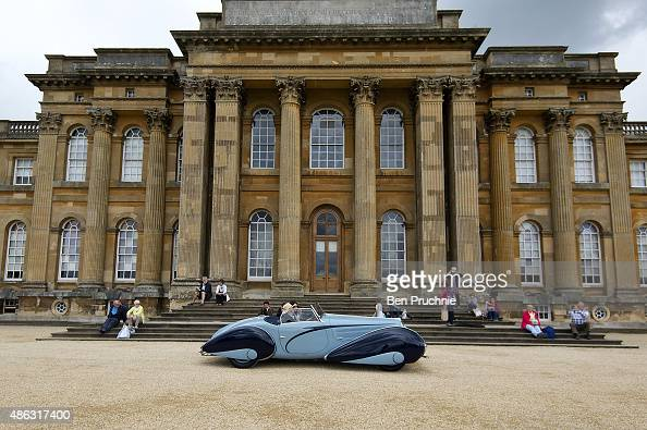 A classic car drives past Blenheim Palace at the Salon Prive luxury car event at Blenheim Palace on September 3 2015 in Woodstock England Salon Prive...
