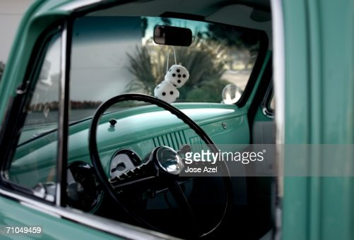 classic car with fuzzy dice hanging from the rearview mirror stock photo getty images. Black Bedroom Furniture Sets. Home Design Ideas