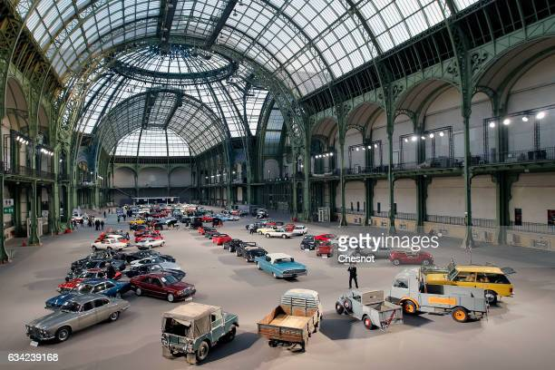 Classic cars and motorcycles are displayed during a press preview before a mass auction of vintage vehicles organised by Bonhams auction house at the...