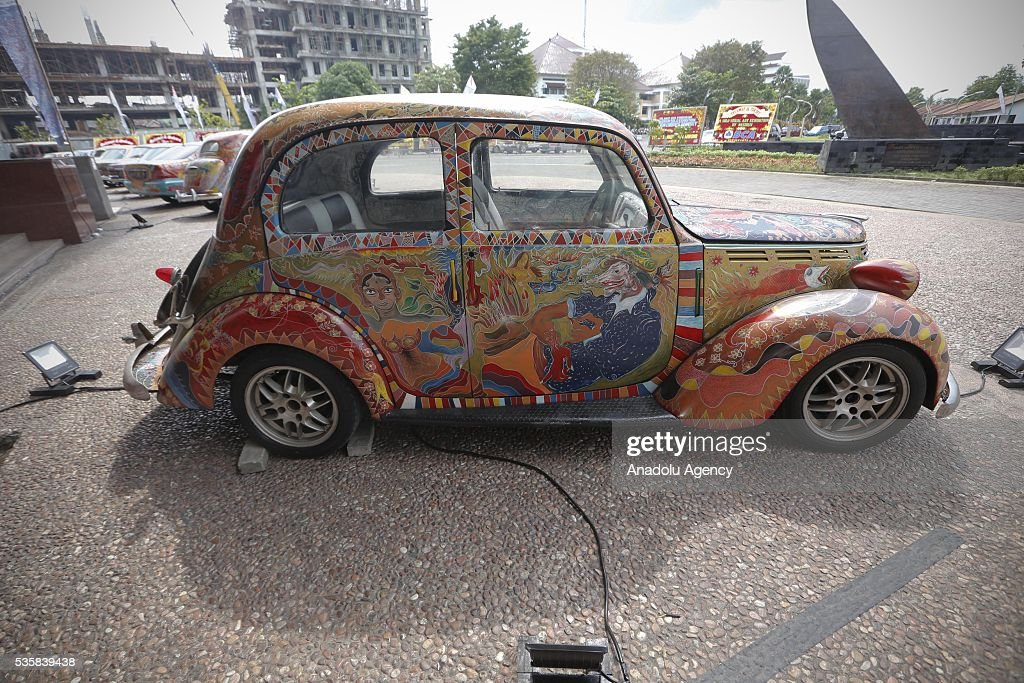 Classic cars painted by Nasirun are seen during a solo art exhibition in Yogyakarta, Indonesia on May 30.