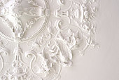 Ceiling part in rich stucco decor. Used to be decor element for a light fixture or luster.