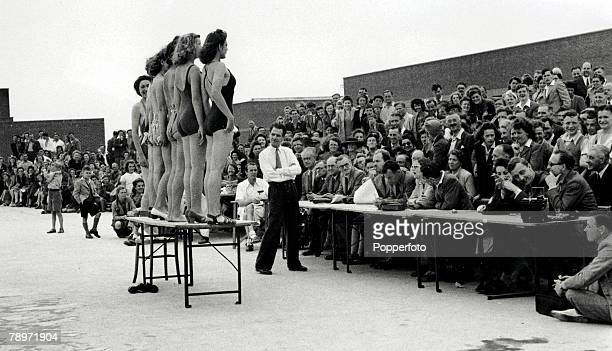 Classic Collection Page 10401159 8th August 1945 Yorkshire England Women entering a beauty contest standing on a table in front of a crowd of holiday...