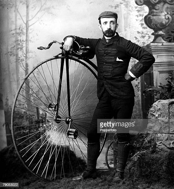 Classic Collection Page 132 Old studio portrait of man standing next to Penny Farthing bicycle