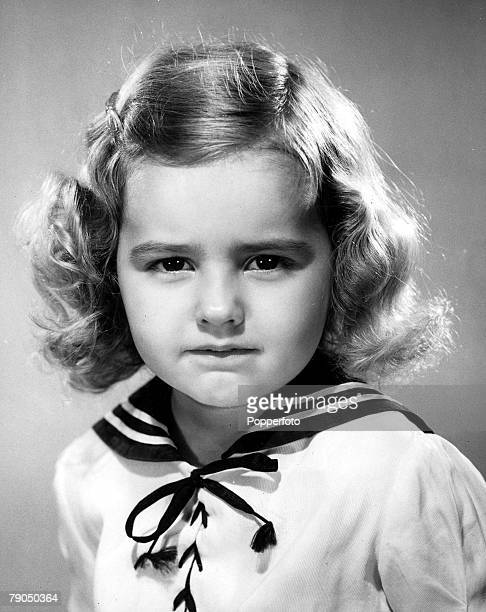 Classic Collection Page 32 10 379729 Portrait of a little girl with a stern face curly hair wearing a sailor suit