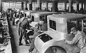44 Detroit Michigan USA circa 1927 A group of men working on an assembly line of car bodies at the Ford motor plant in Detroit