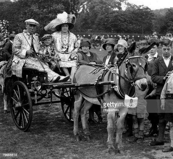 Classic Collection Page 70 Kensington Gardens London 30th June 1930 Pearly Kings and Queens sitting on a donkey cart at the Annual Coster and Street...