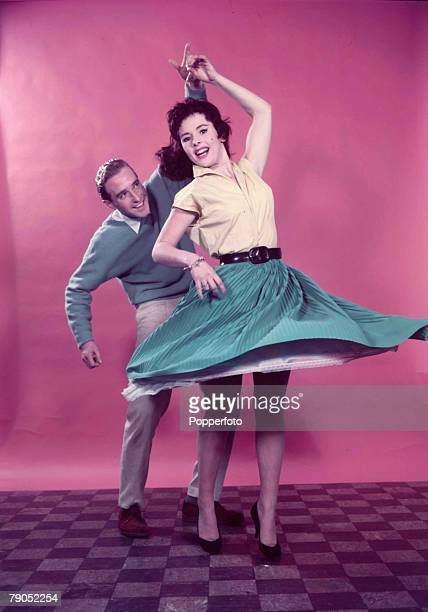 Classic Collection Page 76 1957 Studio portrait of smiling couple Jiving woman in full skirt spinning around