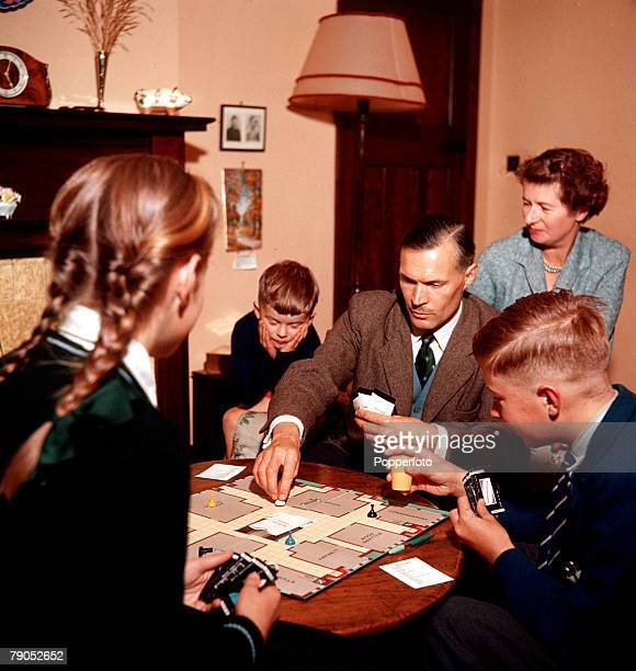 Classic Collection Page 95 1957 Family seated in a livingroom playing 'Cluedo'