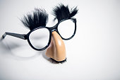 A pair of vintage looking funny costume glasses, with an oversize nose, mustache, and eyebrows attached.  The perfect disguise for hiding looking suspicious when you're trying to not raise suspicion.