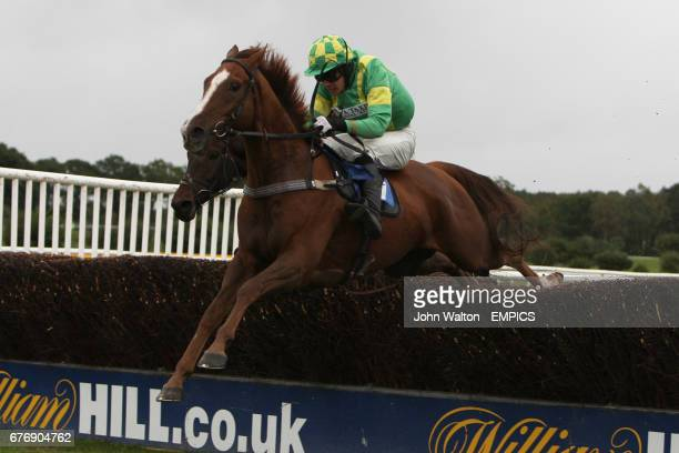 Classic Fly ridden by Felix de Giles jumps the fence during the Betfair iPhone Android App Handicap Chase
