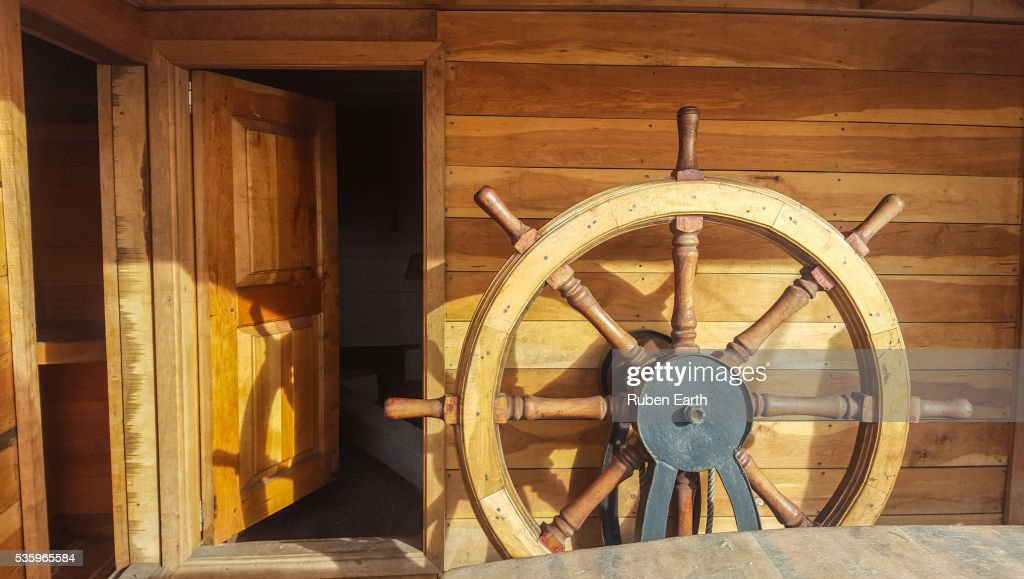 Classic helm on a wooden classic boat : Stock Photo
