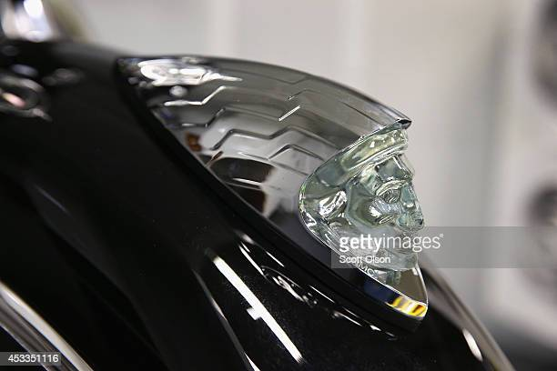 A classic indian head decorates the front fender of an Indian motorcycles sitting on the assembly line at the Polaris Industries factory on August 8...
