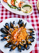 Elements of Italian and Roman cuisine, such as risotto alla pescatora (rice in fish sauce), with mussels and prawns, accompanied by a good white wine. On the top the traditional 'caprese', a simply an