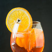 Classic italian aperol spritz cocktail in glass on dark. Close up.