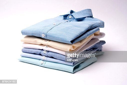 Classic men's shirts stacked on white background : Stock Photo