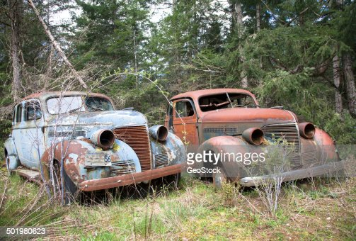Classic Old Cars Rot In A Field Stock Photo Getty Images