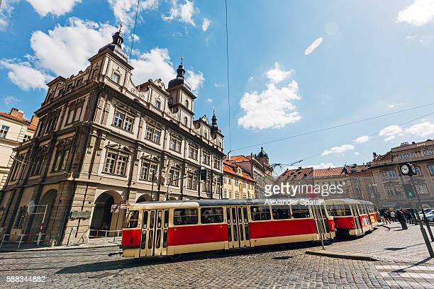 Classic red tram on the streets of Lesser town (Mala Strana) in Prague, Czech Republic