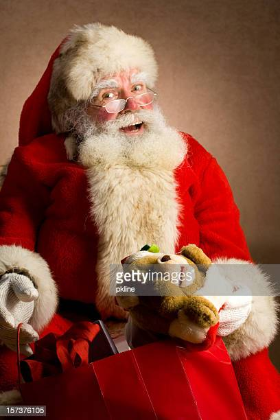 Classic Santa holding a bag of gifts