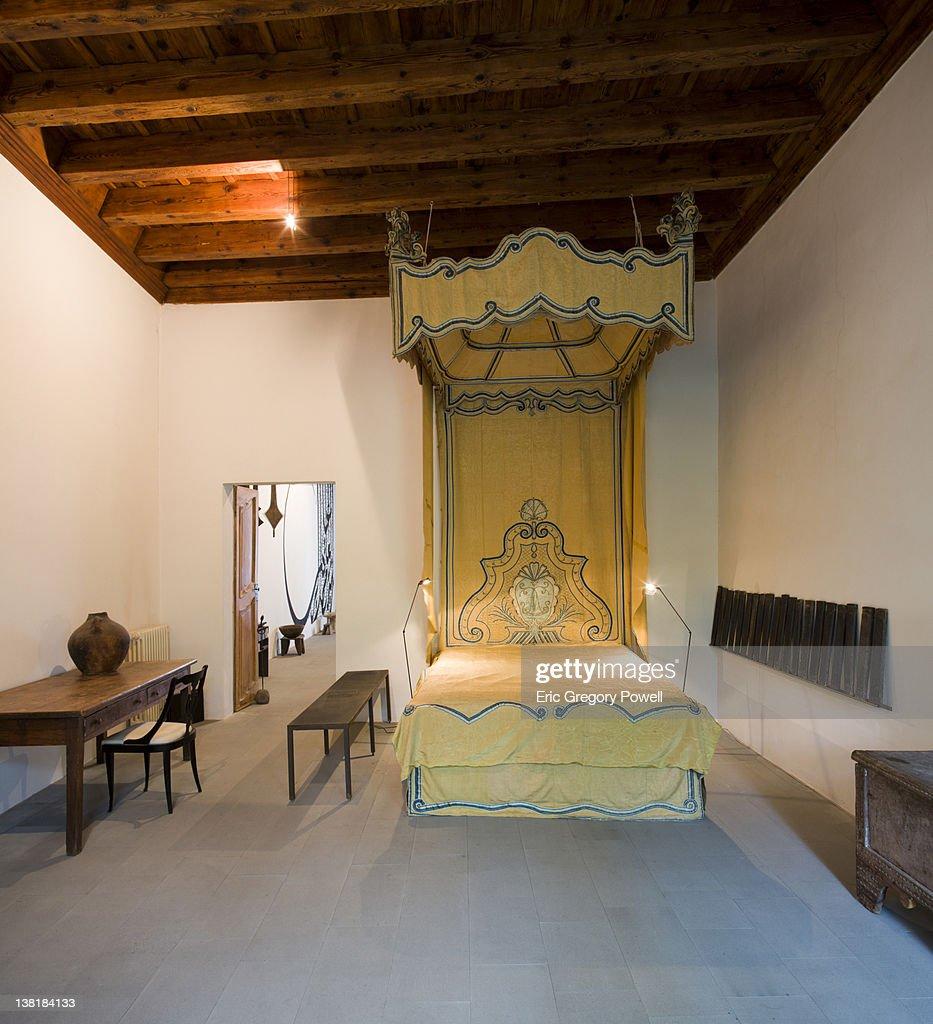 Classic silk bed, Tuscany loft apartment : Stock Photo