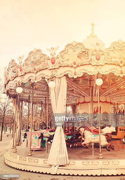A classic white carousel awaits the next group of passengers
