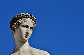 Ancient Roman or Greek goddess marble statue in People's Square in Rome, made in the 19th century (with copy space)