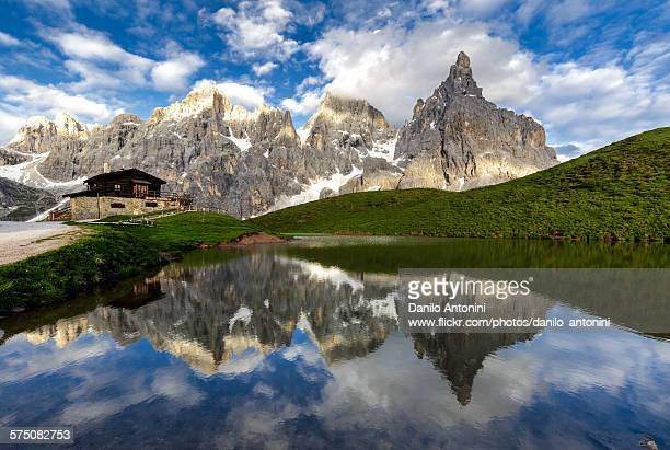 Classical landscape with the Dolomites reflected