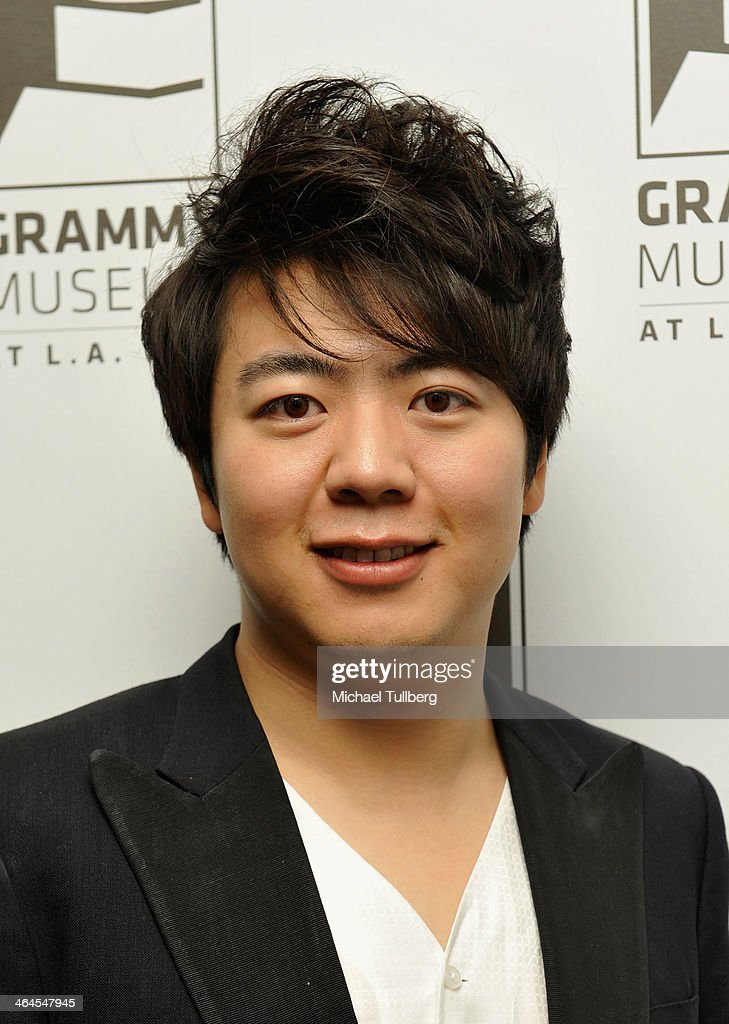 Classical pianist <a gi-track='captionPersonalityLinkClicked' href=/galleries/search?phrase=Lang+Lang&family=editorial&specificpeople=589153 ng-click='$event.stopPropagation()'>Lang Lang</a> poses backstage at The GRAMMY Museum on January 22, 2014 in Los Angeles, California.