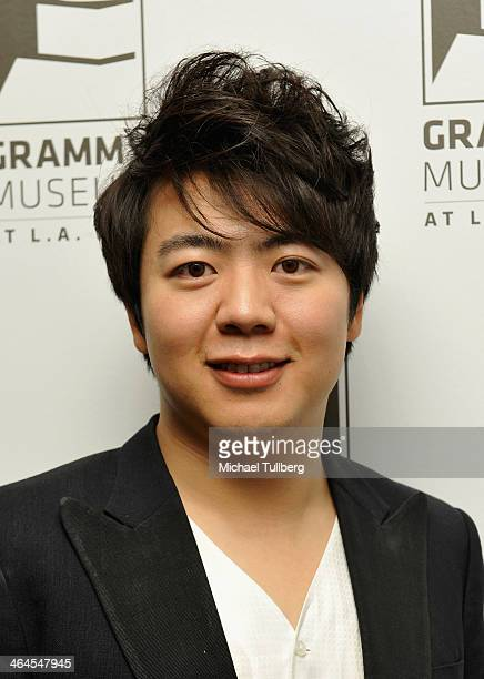 Classical pianist Lang Lang poses backstage at The GRAMMY Museum on January 22 2014 in Los Angeles California