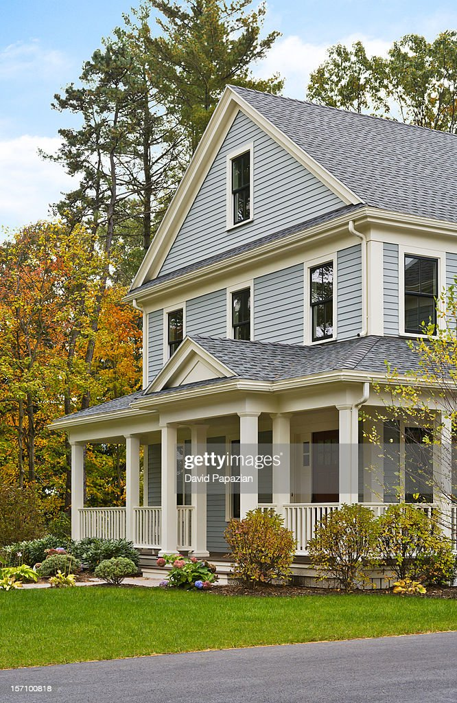 Classic-style American home on a wooded lot : Stock Photo