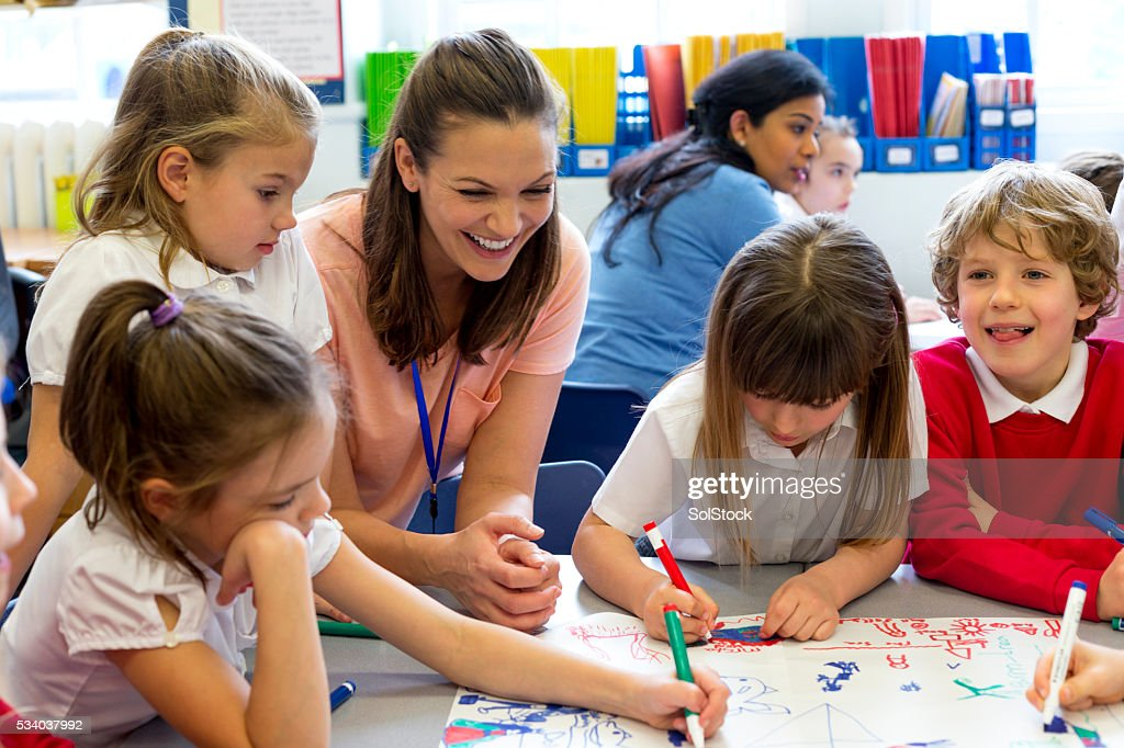 Classmates Drawing Together : Stock Photo