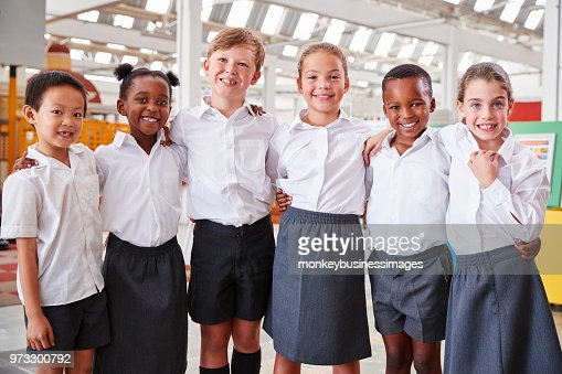 Classmates posing for photo at a science centre : Stock Photo