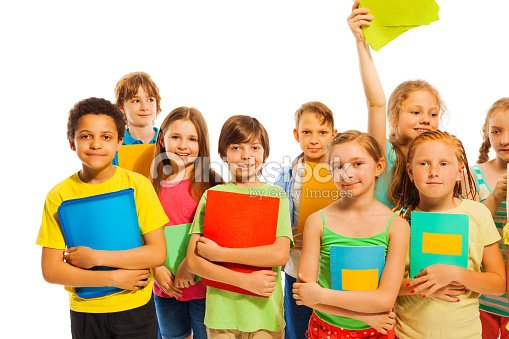 classmates standing together with textbooks stock photo thinkstock